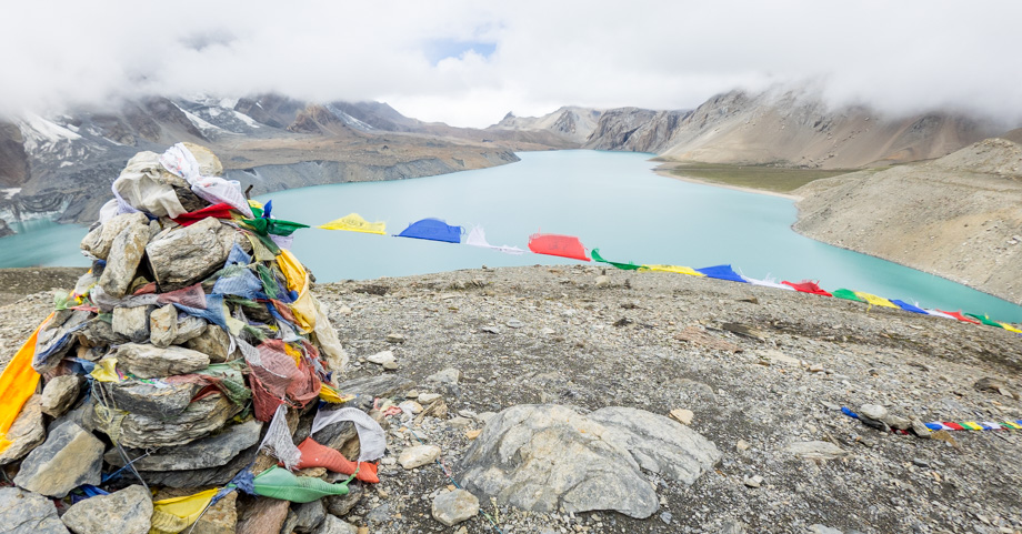 Prayer flags atop Tilicho Lake